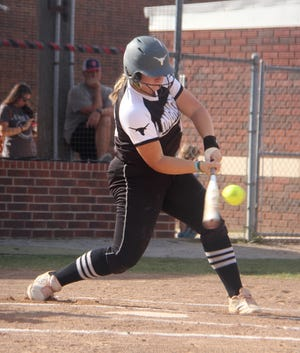 Lone Grove senior Chloe Yeatts makes contact during an at-bat. Yeatts later singled in the top of the 11th to help spark a two-run inning that clinched the 6-4 win over Plainview in extras.