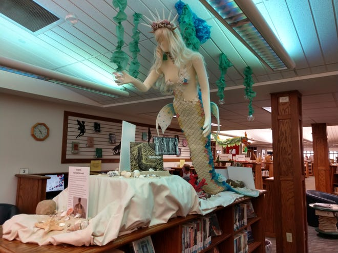 A mermaid floats from the ceiling as part of the Loudonville Public Library's exhibit of Legendary Creatures, in place now through Oct. 30.