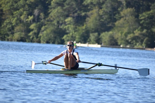 Three-time Olympic rower Gevvie Stone wins the Women's Singles race, with a time of 31:29, at the second annual Head of the Ponds regatta, held Sept. 11 at Mashpee-Wakeby Pond. Stone held the fastest time overall at the Mashpee race among all the singles, doubles and triples competitors.