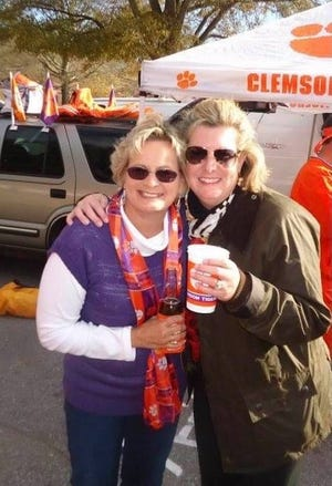 """Margaret """"Maggie"""" Murdaugh, at right, with her friend Debbie Bishop-Phillips at a college football tailgating event."""