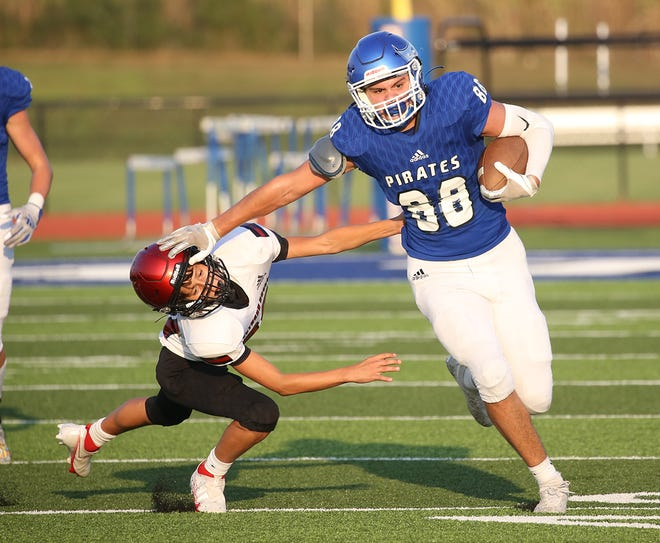 Boonville sophomore Maddex Douglas (88) stiff arms a Southern Boone player in the first half Monday night in junior varsity action at Gene Reagan field.