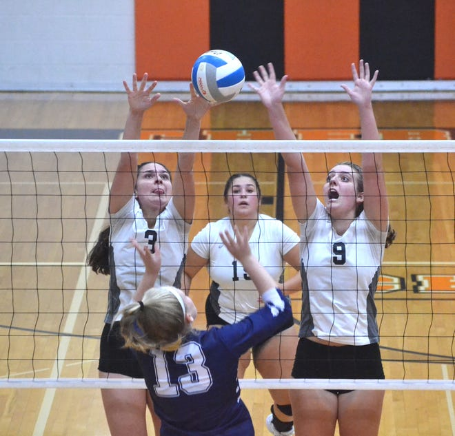 Cheboygan's Kenzie Burt (3) and Kyla Thater (9) go up to block a kill attempt from Sault Ste. Marie's Faith White (13) during the fourth set of a Straits Area Conference varsity volleyball clash on Tuesday.