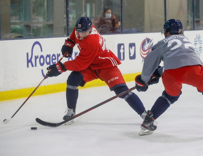 Forward James Malatesta (73) moves the puck around defenseman Jake Christiansen (32) during the Columbus Blue Jackets development camp at the OhioHealth Ice Haus in Columbus on Tuesday, Sept. 15, 2021.