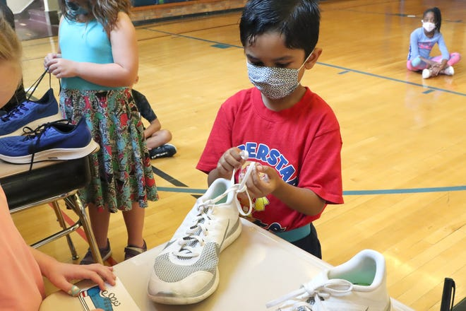 Hanby Elementary School first-grader Anamol Dhungana takes the Shoe Tying Challenge on Sept. 13.