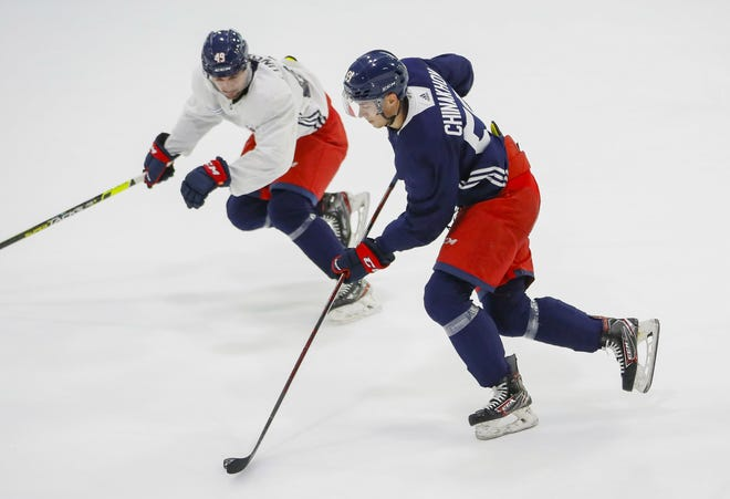 Forward Yegor Chinakhov (59) skates past forward Cole Fonstad (49) during the Columbus Blue Jackets development camp at the OhioHealth Ice Haus in Columbus on Tuesday, Sept. 14, 2021.