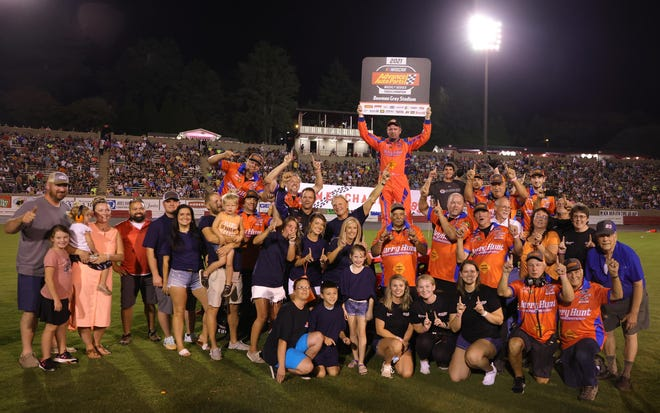 Modified racer Tim Brown celebrates with family, friends and crew after his 11th championship-clinching victory at Bowman Gray Stadium in Winston-Salem on Aug. 21, 2021.