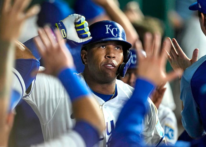 Kansas City Royals catcher Salvador Perez (13) celebrates with teammates after hitting a home run against the Oakland Athletics during the sixth inning of Tuesday's game at Kauffman Stadium. His 43rd home run of the season put the Royals ahead 8-7 and the Royals went on to a 10-7 win after falling behind 6-0.