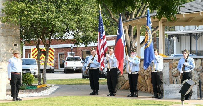 The American Legion, Oliver Windell Buzan, Post 0462 color guard presents the colors at the American Legion Patriots Day ceremony at the Square on Saturday, Sept. 11.