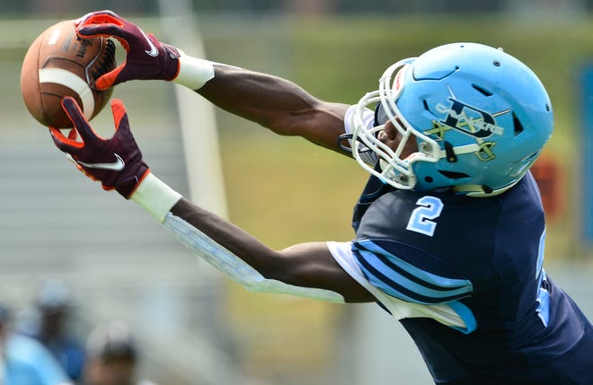 Dorman wide receiver/cornerback D.J. Porter reaching for a pass against Mallard Creek during the McDonald's Kickoff Classic in August. Porter is picking up steam on the recruiting trail.