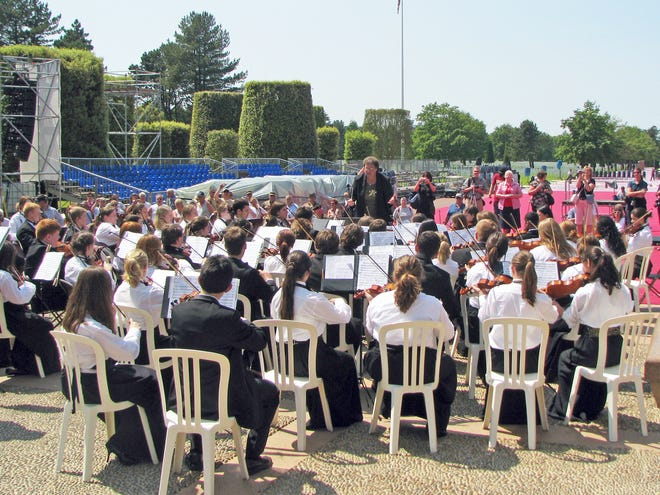 Jane Gouker directs members of the Hoosier Youth Philharmonic in June 2009 as they perform near Omaha Beach in France on the day before the official ceremony for the 65th anniversary of D-Day.