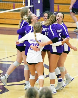 Bloomington South celebrates after winning a point during the Bloomington North-Bloomington South volleyball match at South Tuesday evening. (Bobby Goddin/Herald-Times)