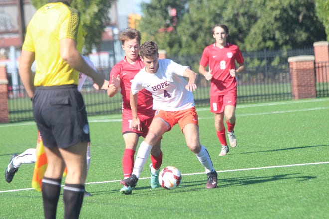 Hope defender Brett Dyer wins the ball from a WashU player