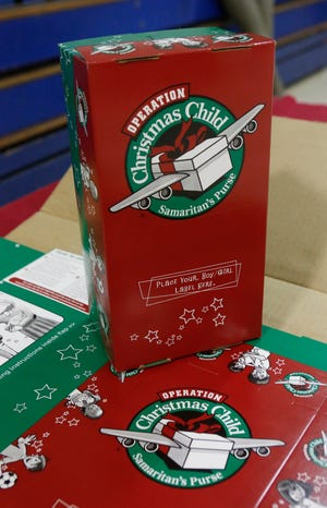 An Operation Christmas Child shoebox is displayed at the New River Baptist Association during a program kickoff event, October 2012.