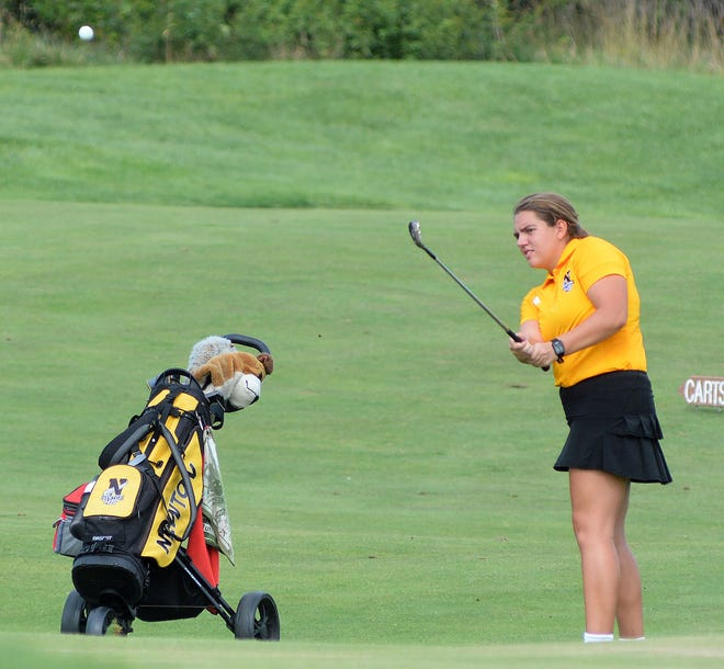 Newton golfer Lindsey Warsnak chips to the 16th green at Sand Creek Station at the Newton Invitational. Warsnak claimed a medal by placing 11th. Newton was third out of nine in the team standings. The Railers compete Monday at the Salina South Invitational.