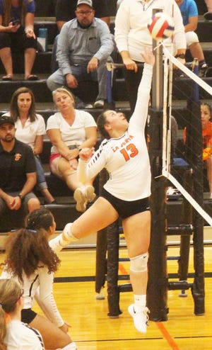 La Junta High School's Angelina Sanchez goes up for a kill in the Tigers' five-set victory over Buena Vista on Tuesday, Sept. 14, 2021.