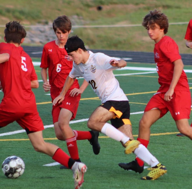 Keyser's Seth Earnest navigates through traffic against Southern. Earnest was credited with two goals in the win.