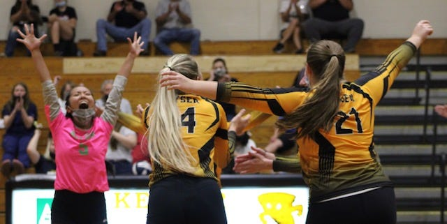 The Keyser volleyball squad excitingly celebrates a point in their victory Monday.