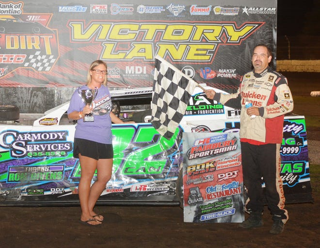 Metamora's Tommy Duncan is joined by his wife, Tisha in Fairbury's victory lane. Duncan captured his third straight CR Towing Sportsman track championship.