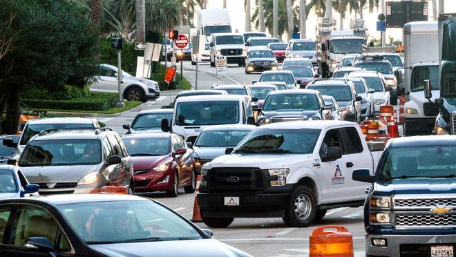Traffic backs up on eastbound Okeechobee Boulevard Monday morning, November 6, 2017 as the road remains closed  at the Florida East Coast Railroad crossing in downtown West Palm Beach for crossing rehabilitation.  During the closure, workers are repairing defective rails and replacing the surface to improve ride quality.  It is scheduled to reopen at 6 a.m. Tuesday.  (Lannis Waters / The Palm Beach Post)