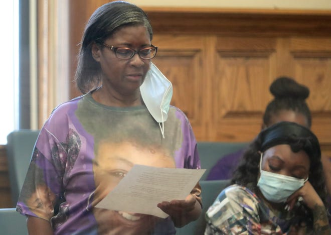 Darlene Russell, mother of murder victim Renee Russell of Canton, reads a prepared statement Wednesday at the sentencing of Tahi Nelson in Stark County Common Pleas Court. He was sentenced to 21 years to life in prison.