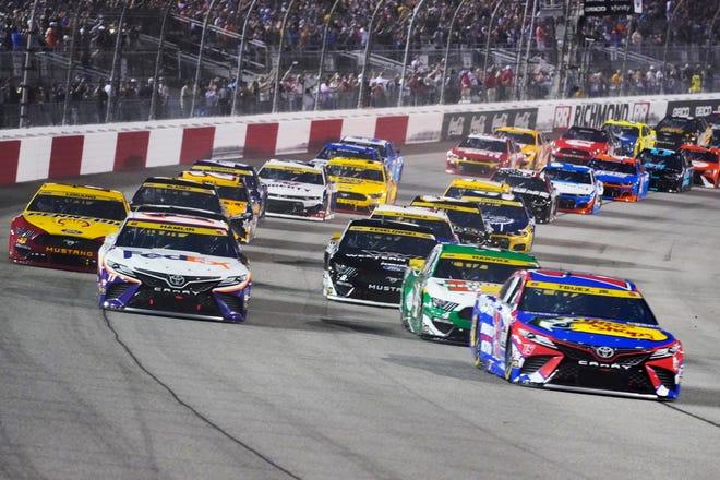 Denny Hamlin (11) and Martin Truex Jr., (19) lead the field to start of the NASCAR Cup series race in Richmond, Va., Saturday, Sept. 11, 2021.