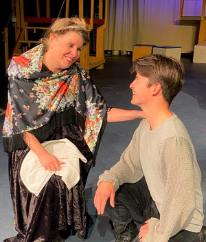 Grandma Berthe, played by Kate Blain, gives some loving advice to grandson Pippin, played by Martin Kamm.
