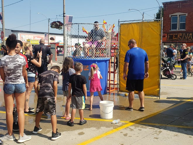 Hog Days 2021 has been declared a success by committee members. Monday was Kid's Day for the festival. Shown, area kids lined up to dunk members of the Kewanee Police Department.