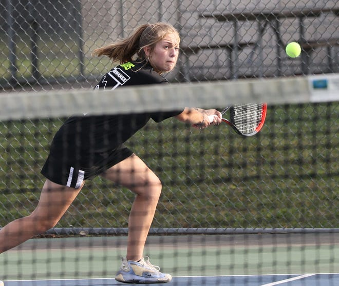 Kewanee's Maya Davis chases down the ball in the tennis match with Sterling on Monday, Sept. 13, in Northeast Park.