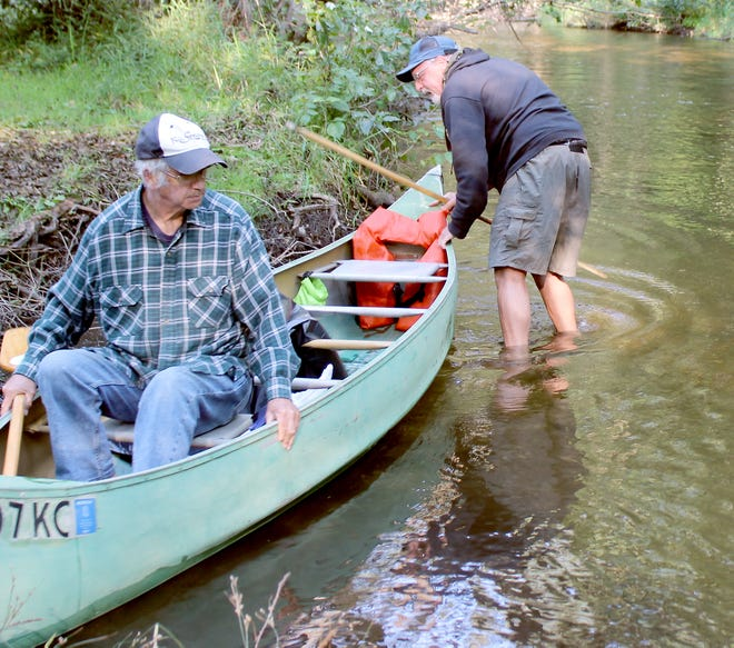 Pat McCarty and Chuck Hemphield get ready to embark on the final river cleanup of 2021, held Sept. 11 on Prairie River.