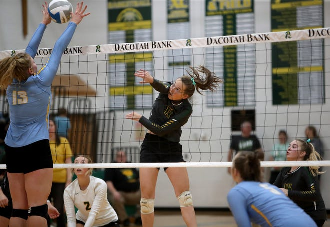 Aberdeen Roncalli middle hitter Ava Hanson hits the ball past Hamlin middle hitter Gracelyn Leiseth during Tuesday's match at the Roncalli Gym. American News photo by Jenna Ortiz, taken 09/14/2021.