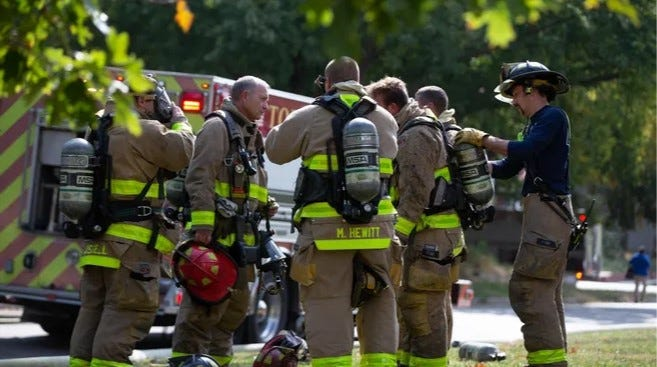 Topeka's mayor and city council voted Tuesday evening to enter into an employment contract with the city's rank-and-file firefighters, some of whom are shown in this photo take at a fire scene last October.