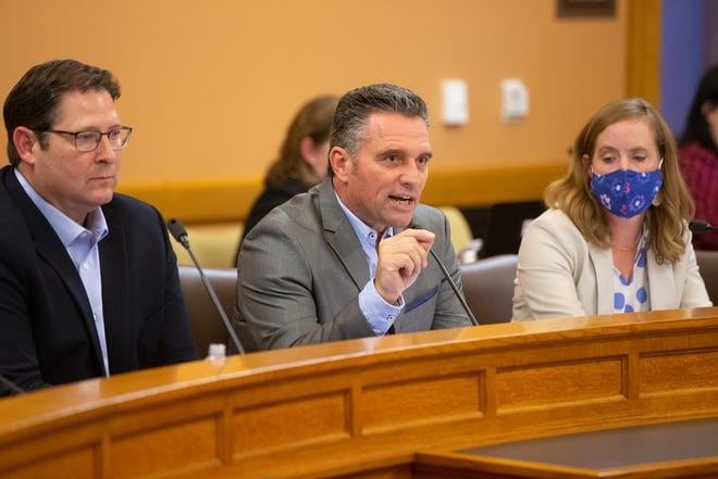 Kansas Senate President Ty Masterson, middle, R-Andover, discusses President Biden's vaccine mandate for federal workers during the Legislative Coordinating Council meeting at the Statehouse.