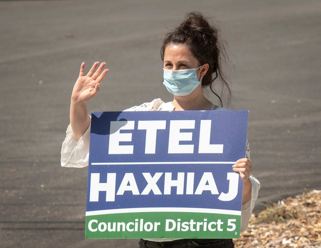 WORCESTER - District 5 City Council candidate Etel Haxhiaj campaigns outside an early voting location at the Unitarian Universalist Church on Holden Street Tuesday, September 7, 2021.
