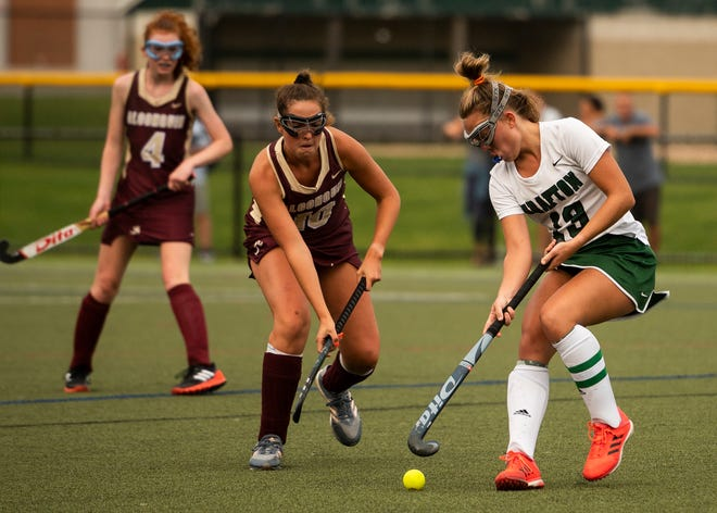 Grafton's Anneliese Oetsen and Algonquin's Nicole Egizi in action during Tuesday's game.