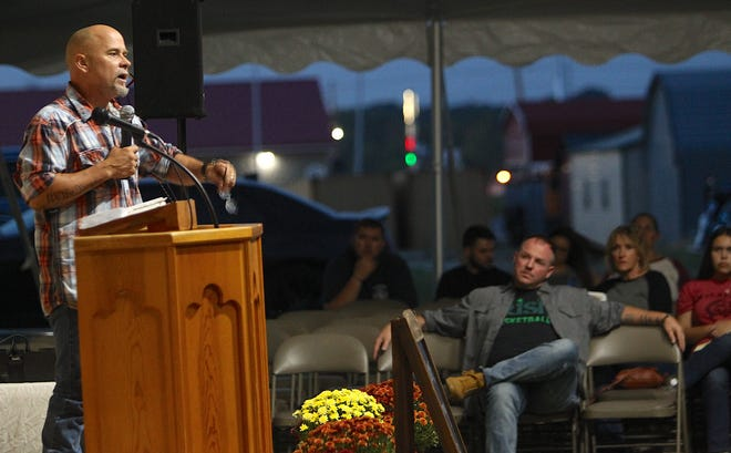 """Jim Gore, the owner of Smokin' Jim's BBQ and Steakhouse speaks at the """"Watchmen on the Wall"""" tent revival Monday evening. The revival, located at 3520 16th St., (just South of Revere's Food and Fuel), started Sunday, and will have a speaker every evening at 7 p.m., with the final night being Sunday, Sept. 19."""
