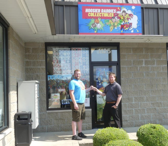 Andrew Thomas (Right) with store manager Cody Grogan (left) in-front of Hoosier Daddies Collectibles