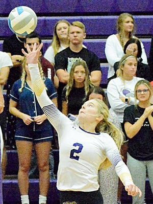 Watertown's Trinity Hodorff leaps to tip the ball over the net during a high school volleyball match against O'Gorman on Tuesday night in the Civic Arena. Top-rated Class AA O'Gorman won 3-0.