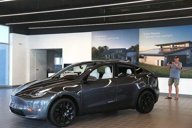 A Model Y is shown at a Tesla dealership in Norwell, Mass. on Tuesday, Sept. 14, 2021.