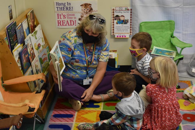 Hot Springs Early Childhood Education Center's Lis Marcy reads a book to students Sept. 14. There are currently 15 students enrolled at the center, the first in Hot Springs since 2019.