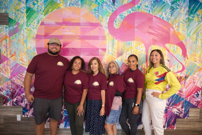Members of the Battle Creek Latin-American Heritage Initiative planning committee pose for a photo at Cafe Rica in downtown Battle Creek on Wednesday, Sept. 15, 2021.
