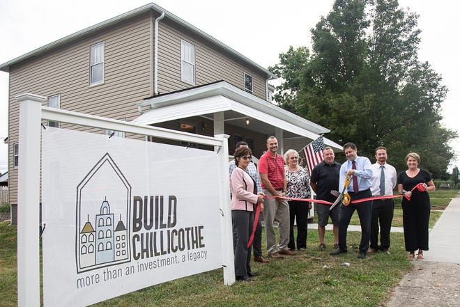 Jay Seigneur, president and founder of build Chillicothe, leads a ribbon-cutting for their new Water Street property on Wednesday, Sept. 15, 2021, in Chillicothe, Ohio.