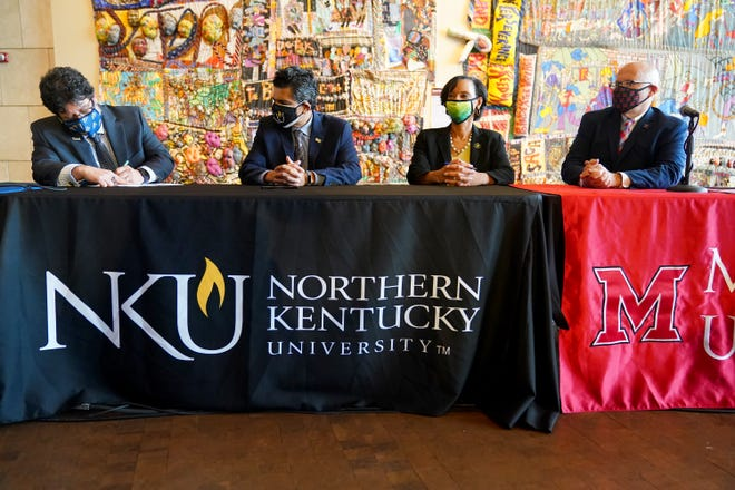 """Fernando Figueroa (left), president of Gateway Community and Technical College, Ashish Vaidya, president of Northern Kentucky University, Monica Posey, president of Cincinnati State and Gregory Crawford, president of Miami University, sign a memorandum of understanding to launch the """"Moon Shot for Equity,"""" a national initiative to close racial and ethnic equity gaps in higher education by 2030, Wednesday, Sept. 15, 2021, at the National Underground Freedom Center and Museum in Cincinnati."""