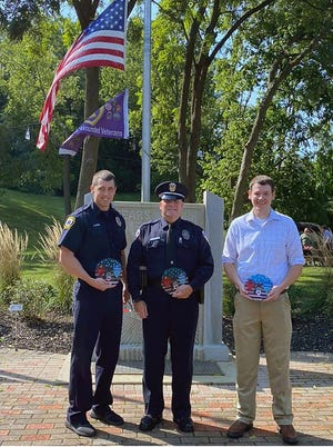 The Fairfield Community Foundation's Hometown Heroes received a custom plaque and a cash award during a program to commemorate the 9/11 terrorist attacks. Pictured from left are firefighterJeff Vater, police officer Greg Bailes and nurse Matthew Dameron.