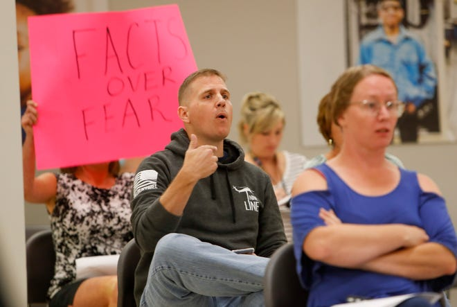 Michael Gray yells at board members after a 5-2 vote is cast in favor of a mask mandate for schools during a school board meeting at CMCSS headquarters in Clarksville, Tenn., on Tuesday, Sept. 14, 2021.