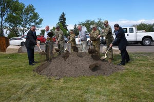 Great Falls city leaders and local military members participate in the ceremonial first shovel of dirt during the groundbreaking ceremony of the new indoor aquatics and recreation facility at Lions Park on Wednesday.