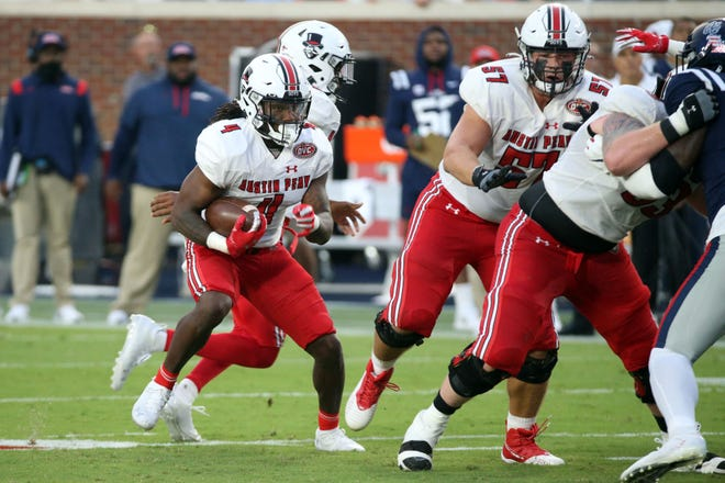 Sep 11, 2021; Oxford, Mississippi, USA; Austin Peay Governors running back Brian Snead (4) runs the ball during the second quarter against the Mississippi Rebels at Vaught-Hemingway Stadium. Mandatory Credit: Petre Thomas-USA TODAY Sports