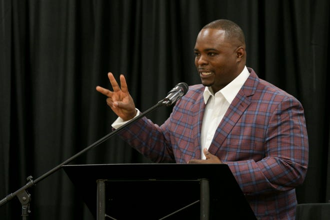 Donte Wilburn, owner of Premier Detailing and Wash LLC, speaks after being presented with the 2021 Small Business Week Entrepreneur of the Year Award, Wednesday, Sept. 15, 2021 in Lafayette.