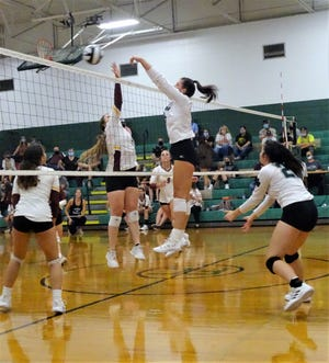 Fisher Catholic's Averie Bruce blocks a Berne Union shot at the net during Mid-State League-Cardinal Division play Tuesday night. The Rockets swept the Rockets.
