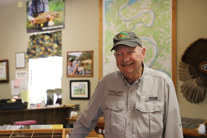 Henry Seay smiles for the camera at Natural State Fly Shop. Seay has been working on the White River for the past 16 years.