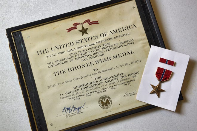 Photo of a Bronze Star and its certificate that were found at a flea market by Harry Kaplan, 73, of Newton, the commander of the American Legion Post 86 in Newton.  Photographed at American Legion Post 86 in Andover Township on 09/15/21.